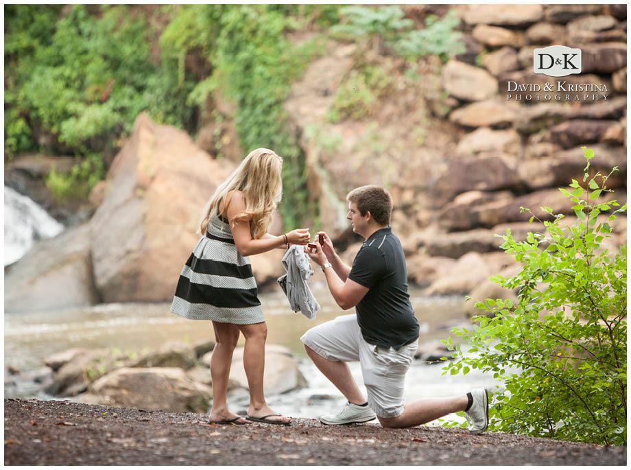 Adam opens the ring box to show Lauren the diamond