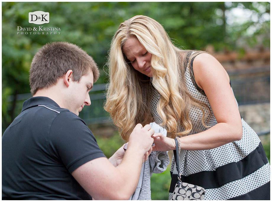 Adam puts the ring on Lauren's finger