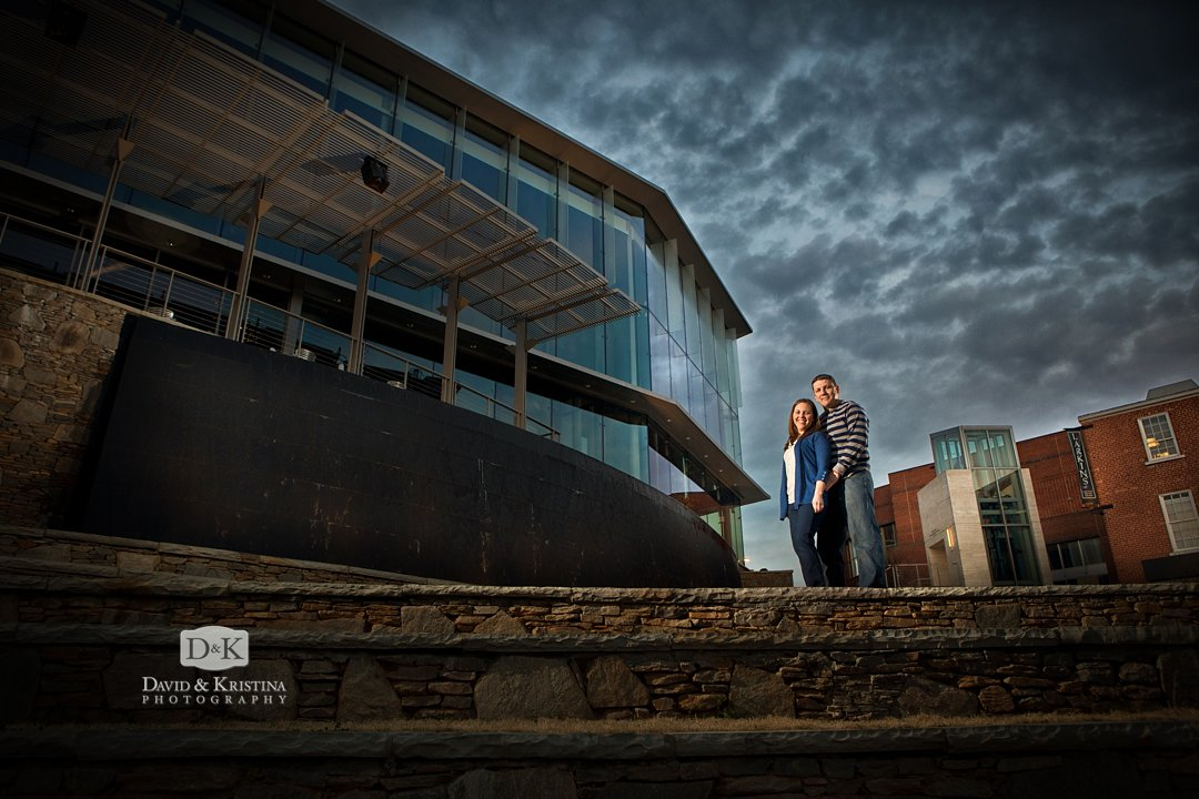 dramatic engagement photos behind Peace Center in Greenville