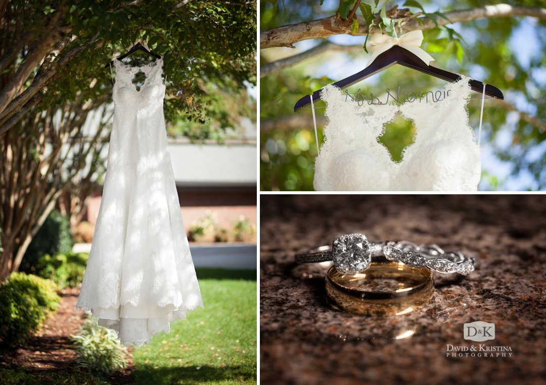 wedding dress hanging from a tree and rings on marble surface