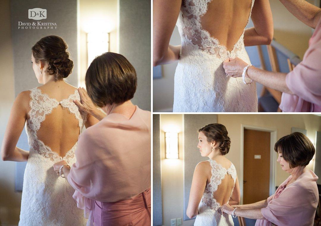 Laura putting on wedding dress