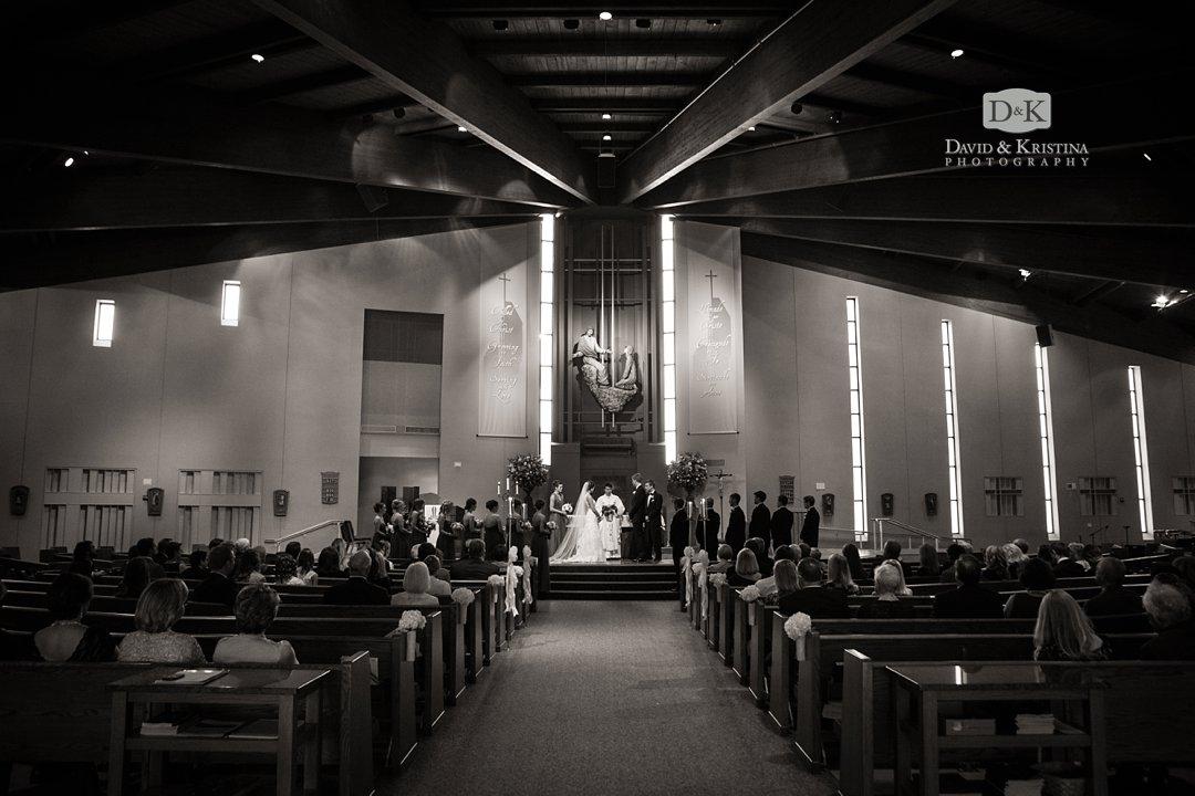 interior of St. Mary Magdalene Catholic Church during wedding black and white photo