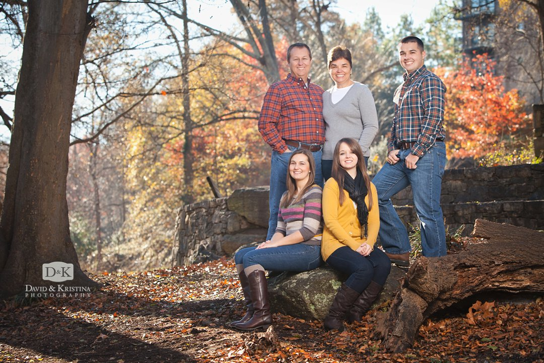 Fall Family photos with colorful leaves at the Old Mill Garden in Falls Park