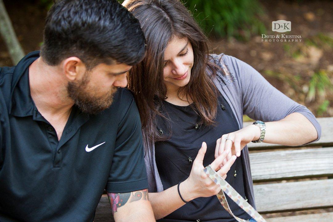 Deborah looks at ring